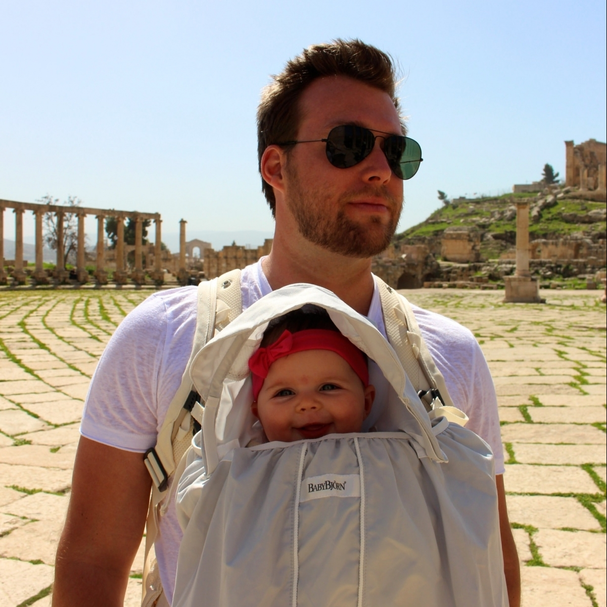 dad baby wearing baby bjorn sun shield