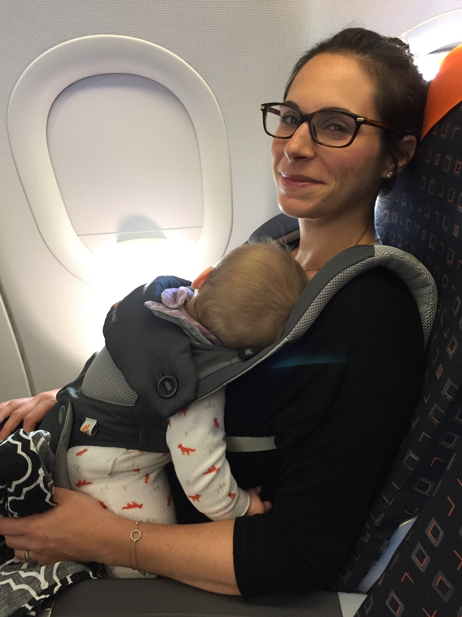 flying with a baby with baby wearing
