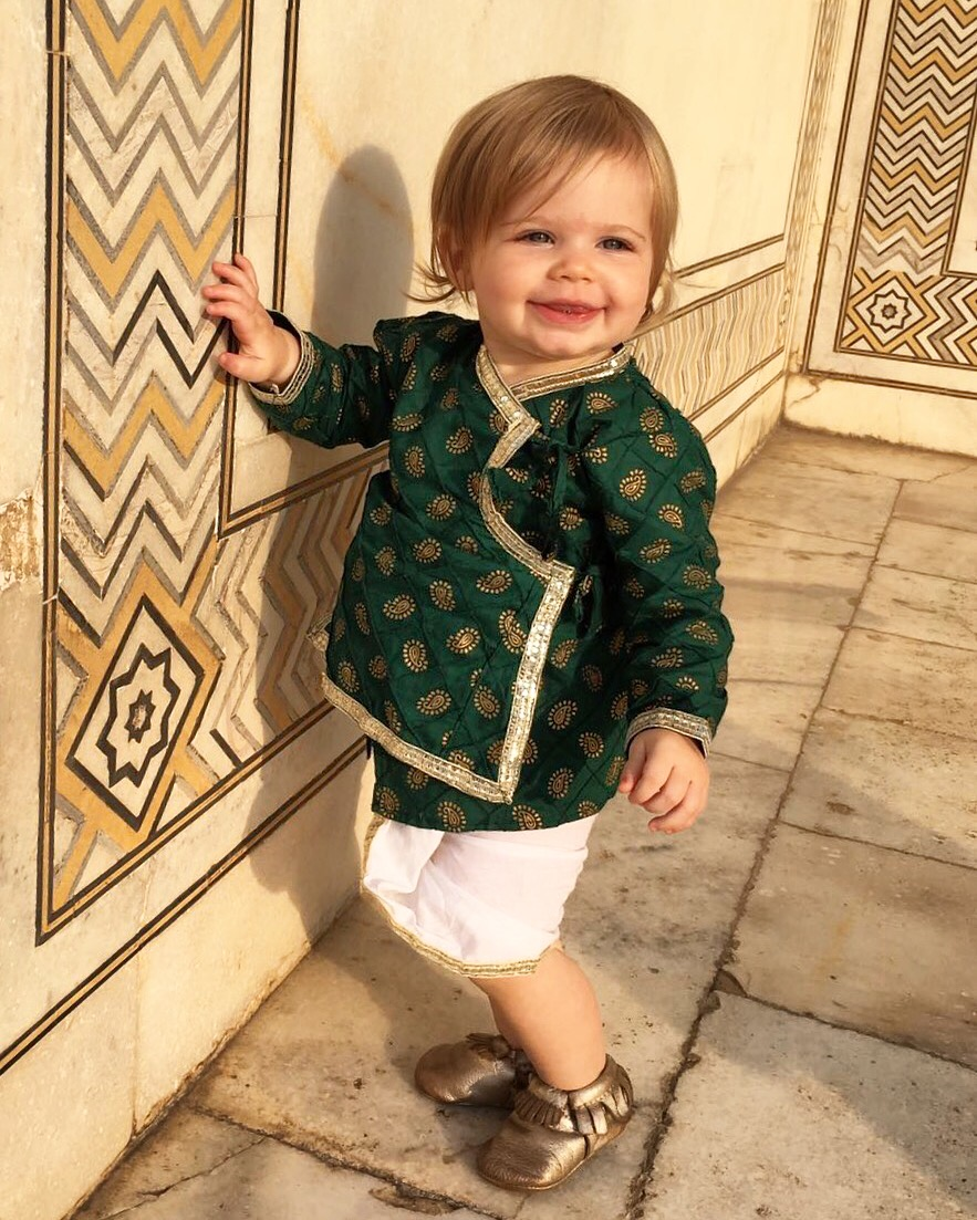 freshly picked baby travel learning to walk in india